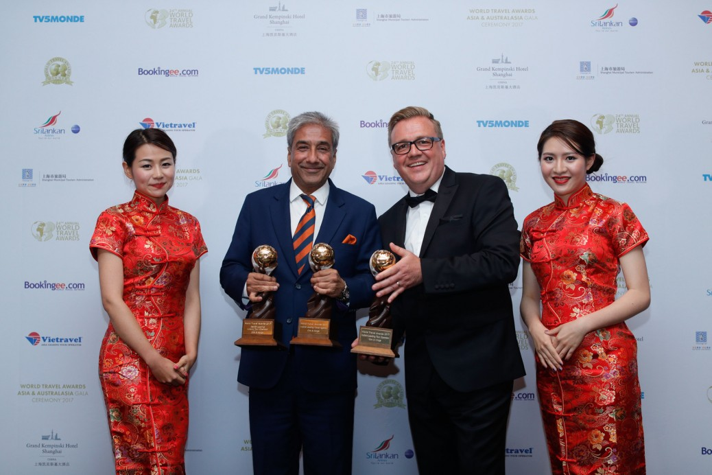 Sandeep Dayal, Head of Sales and Business Development, Cox & Kings (left) displaying the trophies along with Chris Frost, Vice President, World Travel Awards (right) at the World Travel Award ceremony in China.