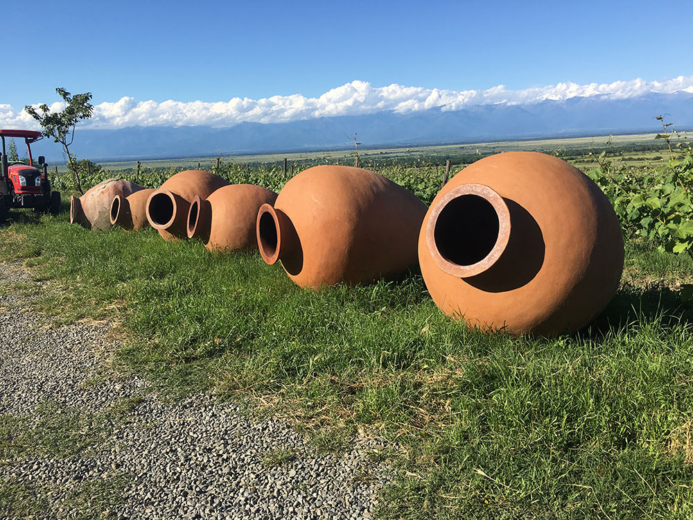Georgian qvevri: qvevri are huge, egg-shaped clay vessels that are buried in the earth, which Georgians use to macerate, ferment, age, and store wines.