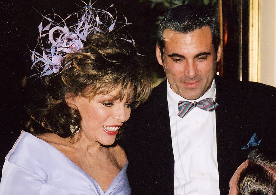 Joan Collins and Alan Nevins at her wedding in London, February, 2002.